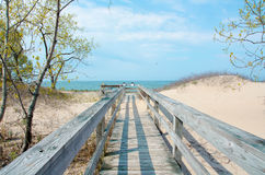 Wood bridge to the beach. A wood bridge leading over dunes to a beach Royalty Free Stock Photography
