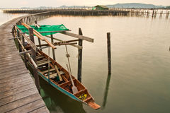 Wood bridge to fisherman house  in sea, Thailand Stock Photo