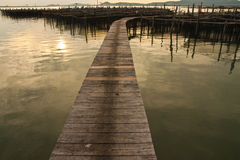 Wood bridge to fisherman house  in sea, Thailand Royalty Free Stock Images