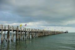 Wood bridge to the sea Royalty Free Stock Photo
