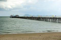 Wood bridge to the sea Stock Photography