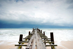Wood bridge in to the sea Royalty Free Stock Photography