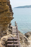 Wood bridge to the sea. Laem Ya Pier at Kao Laem Ya-Moo Koh Samed National Park ,Thailand Stock Photo