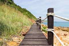 Wood bridge to the sea Royalty Free Stock Images