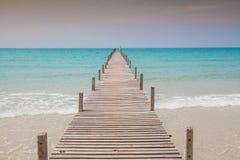 Wood bridge to sea Stock Image