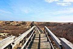 Wood Bridge Walk over Protected Sand Dunes. This walk way is over the protected sand dunes in Plum Island Ma. Just over the horizon is the Atlantic Ocean stock photography