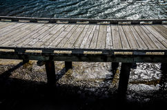 Wood bridge. And water wave stock images