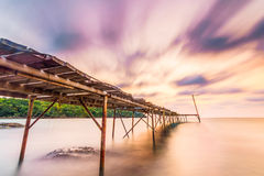 Wood briged at small island. Long explosure wood briged at small island pier and smoothe clouds Stock Photos
