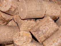 Wood briketter arkivbild