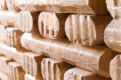 Wood briquet. S in the cellar to heat for the winter Stock Photography