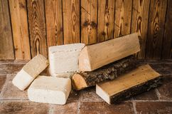Wood briquette and firewood, close-up stock images