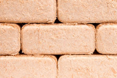 Wood briquettes isolated on white background.Firewood.Briquettes. Briquettes made of sawdust lie on a white background Stock Photos