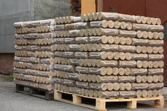 Wood briquettes on pallets Royalty Free Stock Photos