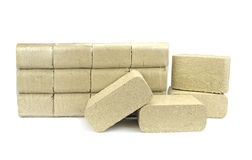 Wood briquettes ( pressed sawdust ) isolated on white background Royalty Free Stock Photography