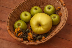 Wood brown background with a basket of green apples. Wood brown background with a wicker basket of green apples Stock Photos