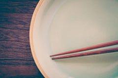 Wood brown chopsticks and celadon green ceramic Stock Photos