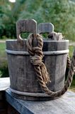 Wood bucket. Bucket is at the well Royalty Free Stock Image