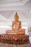 Wood buddha staty Fotografering för Bildbyråer