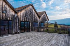 Wood building and deck overlooking Seneca Lake royalty free stock photography