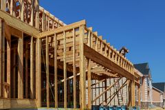 Wood Building frame at Multi-Family Housing Construction. Site post and beam construction royalty free stock photo