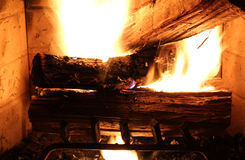 Wood buring in the fire place. Royalty Free Stock Image
