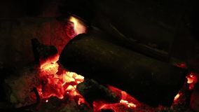 Wood burning in a cozy fireplace at home stock footage