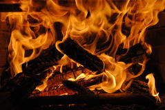 Wood Burning Fire. Raging wood burning fire with hot coals Royalty Free Stock Photos