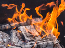 Wood burning in the fire - background Royalty Free Stock Image
