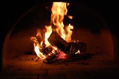 Wood burning in fireplace. Close-up of wood burning in fireplace Stock Images