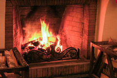 Wood burning in the fireplace. Stock Images
