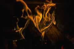 Wood burning in fireplace. Fire and flames in fireplace stock image