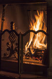 Wood burning in the fireplace Stock Images