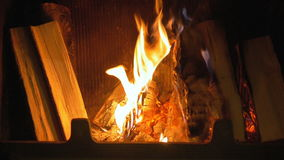 Wood burning in the fireplace. stock video footage