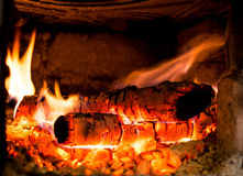 Wood Burning. Logs on fire in the stove Stock Images