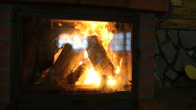 Wood burning in a fireplace stock video footage