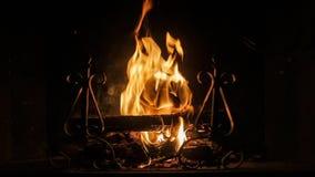 Wood burning fireplace at night in winter season stock footage