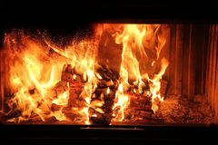 Wood burning in the fireplace red coals. Beautiful wood burning in the fireplace red coals Royalty Free Stock Images