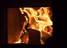Wood burning in the furnace. Tongue of flame royalty free stock image