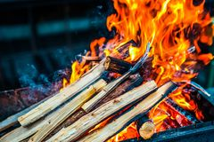 Wood burning in the grill. Fireplace. preparation for barbecue royalty free stock photos
