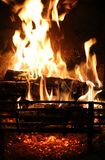 Wood burning at home fireplace Stock Photos