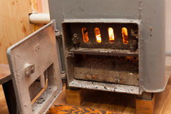 Wood burning inside the Solid bio fuel boiler. Renewable source of energy. green environmentally friendly fuel. Old warm cozy burning fire in a fireplace close stock photo