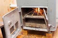 Wood burning inside the Solid bio fuel boiler. Renewable source of energy. green environmentally friendly fuel. Old warm cozy burning fire in a fireplace close stock image