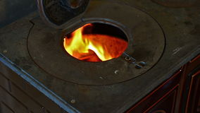 Wood burning in an old style stove stock footage