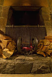 Wood Burning Stone Fireplace. With Logs and Wrought Iron Royalty Free Stock Photos