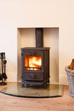 Wood burning stove. Cast iron wood burning stove in a modern contemporary fireplace Stock Photography