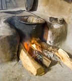 Wood burning stove. A traditional rural wood burning stove in a old country home Stock Photo