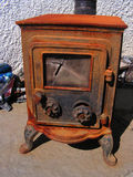 Wood Burning Stove. An old wood burning stove in disrepair with broken glass and rust Stock Photography
