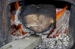 Wood burning in the stove Stock Photography