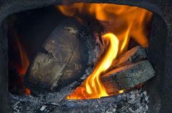 Wood burning in the stove Royalty Free Stock Photo