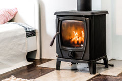 Wood burning stove. In bedroom royalty free stock photos